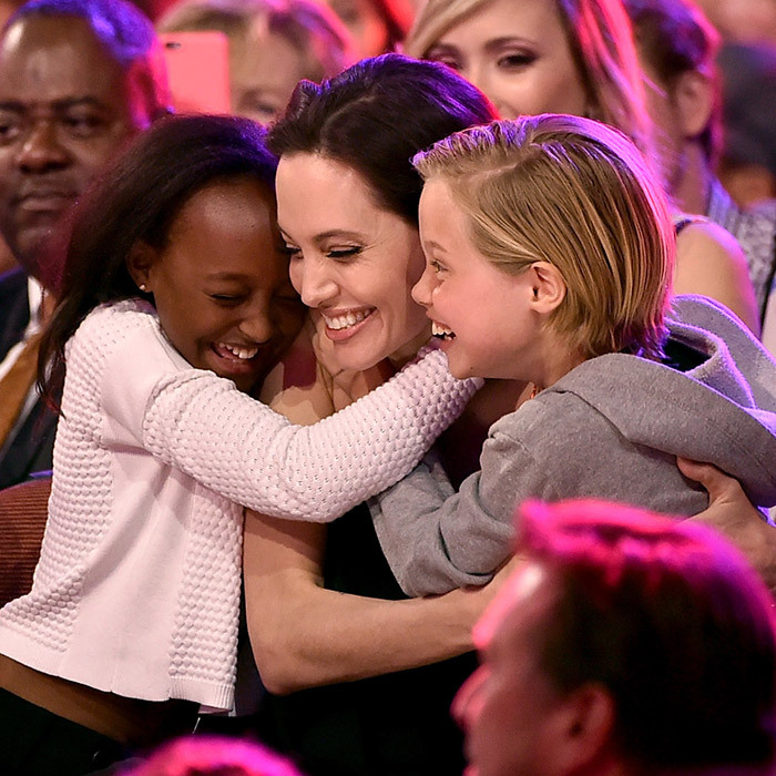 "When Angelina won the award for ""Favorite Villain"" in <I>Maleficent</I> during Nickelodeon's 2015 Kids' Choice Awards in LA, she got a very special prize –  a hug from daughters Zahara and Shiloh.  