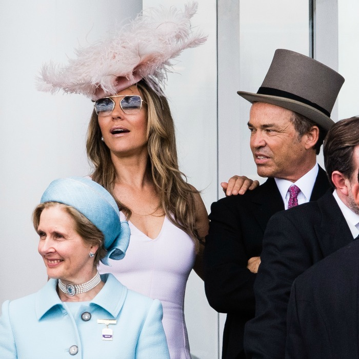 Seated near the Queen was TV 'royal' Elizabeth Hurley. The actress, who looked stunning in a pink dress and matching oversized hat, sat behind racecourse director Julia Budd.