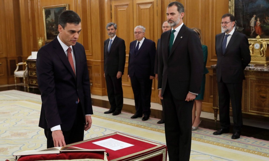 King Felipe VI looked on as Spain's new Prime Minister Pedro Sanchez took his oath during the swearing in ceremony at the Zarzuela Palace on June 02 in Madrid. The new Spanish Prime Minister is an atheist and therefore without a bible or crucifix took the oath of office to protect Spain's constitution.