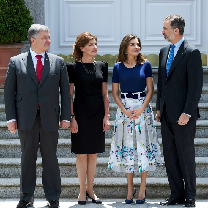 Queen Letizia and King Felipe hosted the Ukrainian president, Petro Poroshenko and his wife, Maryna Poroshenko, for a lunch at Zarzuela Palace in Madrid on Monday, June 4. The 45-year-old monarch looked exceptionally radiant in a casual ensemble, which consisted of a short-sleeved navy top and A-line floral skirt. Letizia's perfect summer look was cinched at the waist with a wide matching belt.