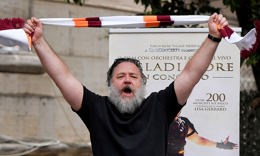 <I>Gladiator</I> star Russell Crowe held an AS Roma soccer fan's scarf as he promoted a charity screening of the Oscar-winning blockbuster on June 5 in Rome. The movie will be screened in the Colosseum on June 6, accompanied by live musicians and choir, to raise funds for the End Polio Now Program. 