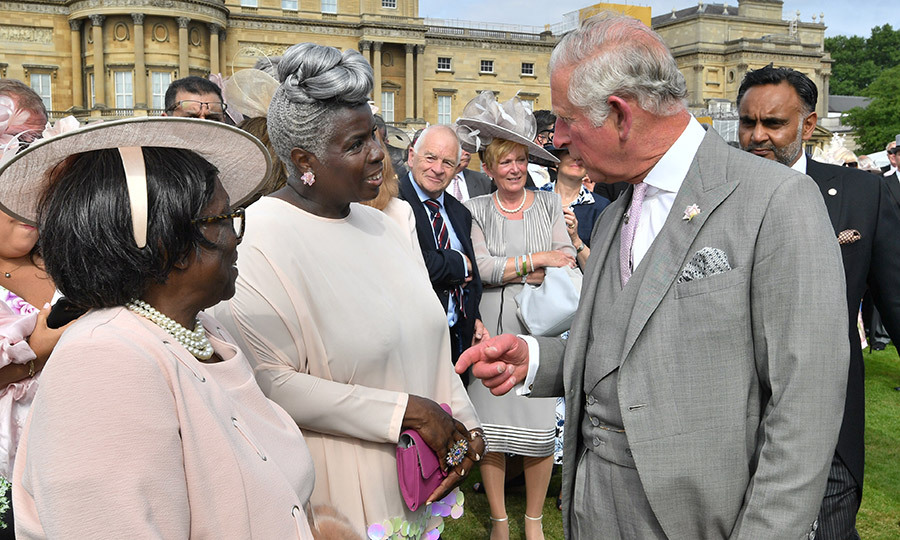 At the June 5 Buckingham Palace garden party, Prince Charles reunited with Kingdom Choir conductor Karen Gibson, who, along with her talented singers, had performed so memorably at Prince Harry and Meghan Markle's royal wedding. Ms Gibson was joined by her mother for the traditional pre-summer royal event. 