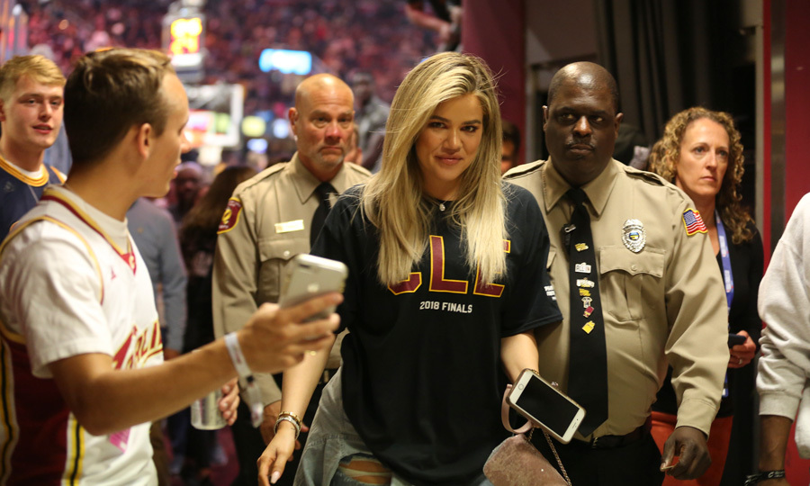 Khloe Kardashian showed her team spirit for Tristan Thompson and his Cleveland Cavaliers during their NBA Finals game against the Golden State Warriors. Despite the teams' loss, the new mom was all smiles walking through the crowd on June 6.  