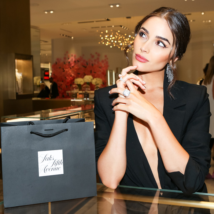 Olivia Culpo had some tough decisions to make while shopping at Saks Fifth Avenue's new jewelry floor. The model-turned-actress tried on a David Yurman ring during the Town & Country sponsored bash.