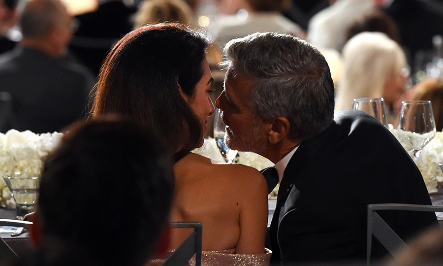 The couple, who married in Venice in 2014, still looked like they were in the honeymoon phase during the gala, sharing whispers and kisses while seated in the audience.