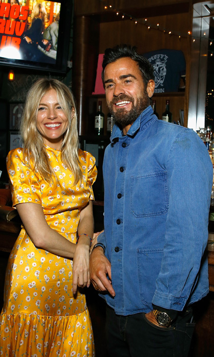 Tanned Justin Theroux and Sienna Miller reunited in NYC at the CHAOS x LOVE magazine party after hanging in the south of France together with friends.