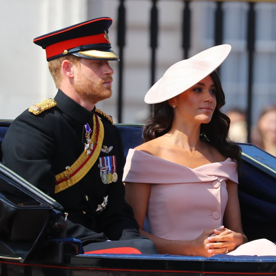 Prince Harry and Meghan Markle were making their first appearance at the Queen's birthday parade less than a month following their royal wedding. The American Duchess opted for US designer Carolina Herrera and a hat by royal favourite Philip Treacy.