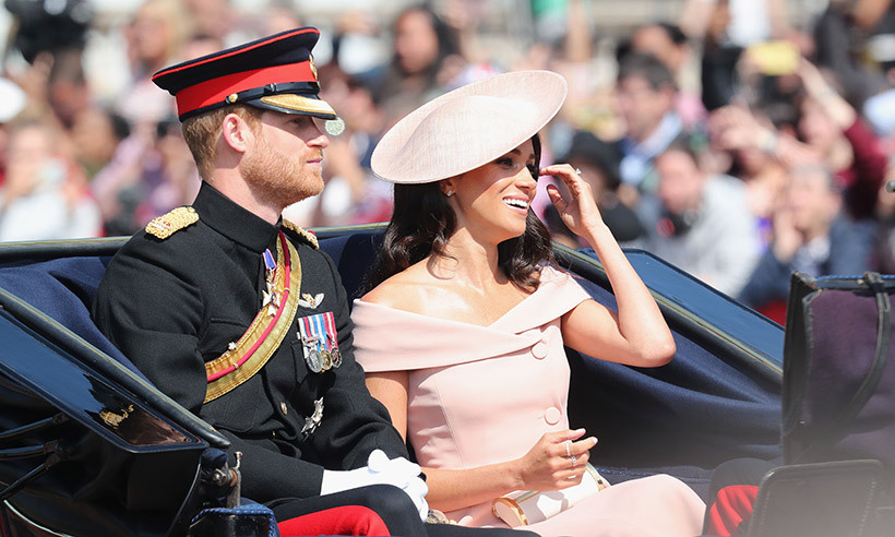 Duchess Meghan is quickly becoming known for her tendency to find the funnier side during royal events, and was spotted laughing alongside Prince Harry during the carriage ride.