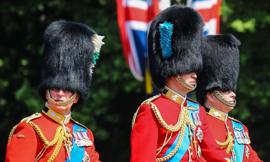 Prince Charles, Prince William and Prince Andrew looked dashing in their military uniforms as well, all wearing bearskin hats for the Queen's official birthday parade.
