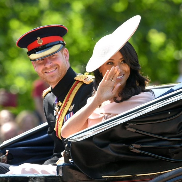 As Prince Harry and Meghan Markle made their Trooping the Colour debut as a married couple, the Prince was all smiles as his new wife showed she has perfected her royal wave while the crowds cheered.
