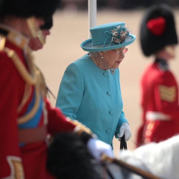 Queen Elizabeth II held onto her trusty handbag as she arrived at The Royal Horseguards.
