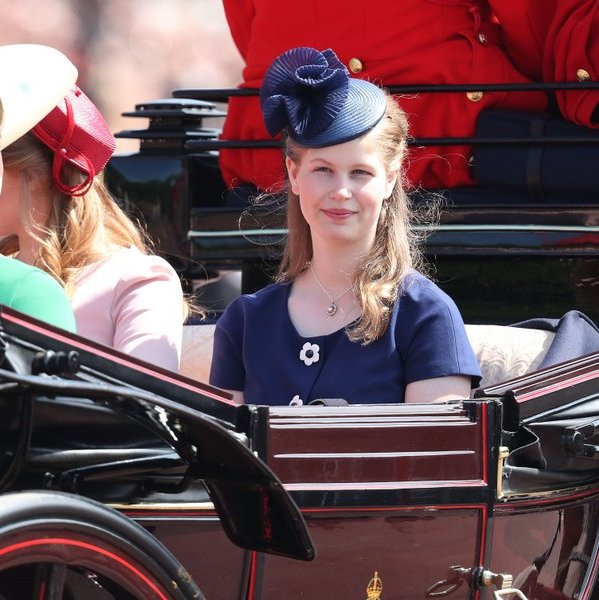 Teenager Lady Louise is becoming increasingly sophisticated with her style, and this year even started wearing high heels! For Trooping the Colour 2018, the royal wore a navy blue dress and sculptural blue hat.