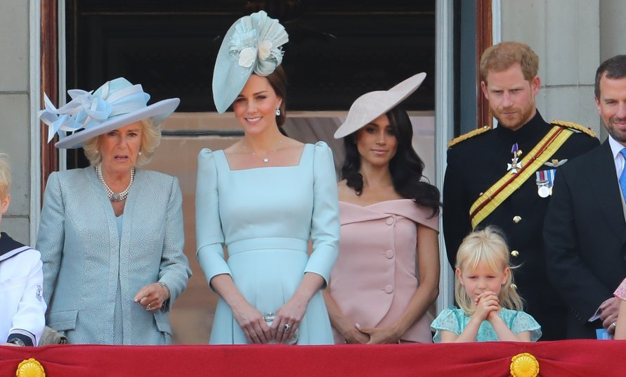 Awaiting their husbands and the Queen, Kate Middleton and the Duchess of Cornwall stood centre stage as the royals first emerged onto the balcony of Buckingham Palace in the countdown to the flypast. Meghan Markle appeared for the first time with husband Prince Harry, to Kate's left. 