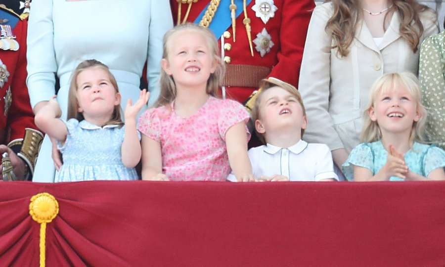 At their great-grandmother Queen Elizabeth's birthday parade, Trooping the Colour, on June 9, 2018, George and Charlotte had a great time with some help from their royal relatives! Savannah Phillips, in pink, and Isla Phillips, far right, joined Princess Charlotte – practising her royal wave – and her little brother on the balcony of Buckingham Palace.