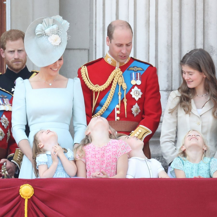 No doubt helicopter-mad Prince George was keeping his eyes on the action, but it looks like all four of the royal children were getting a good neck stretch thanks to the flypast  – much to the amusement of Prince William and Duchess Kate.