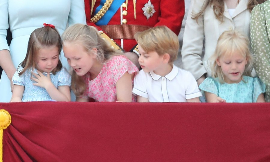 The foursome kept each other entertained during the British royal family's time on the balcony, with oldest cousin Savannah, the seven-year-old daughter of Prince William's cousin Peter Phillips and wife and Autumn, taking charge of the little ones.