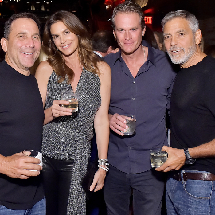 A night after receiving the AFI Tribute Award, George Clooney along with Rande Gerber and Mike Meldman hosted a private Casamigos 'House of Friends' dinner in Hollywood. Cindy Crawford hung with the men though Amal wasn't able to join. During the dinner at TAO LA, the proud dad showed off photos of his and Amal's twins, who just turned one.