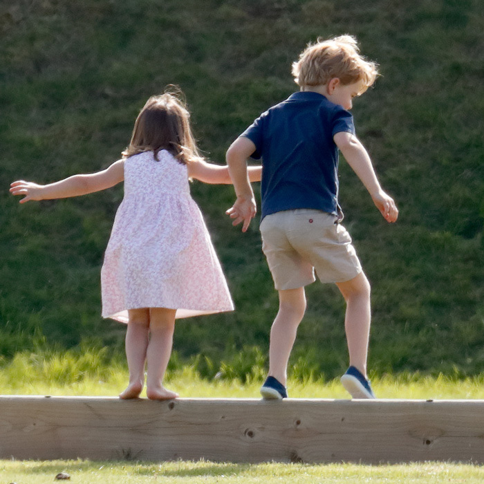 George and Charlotte played together during the polo outing as Kate watched. The little Princess opted to remove her shoes while her brother kept his on.