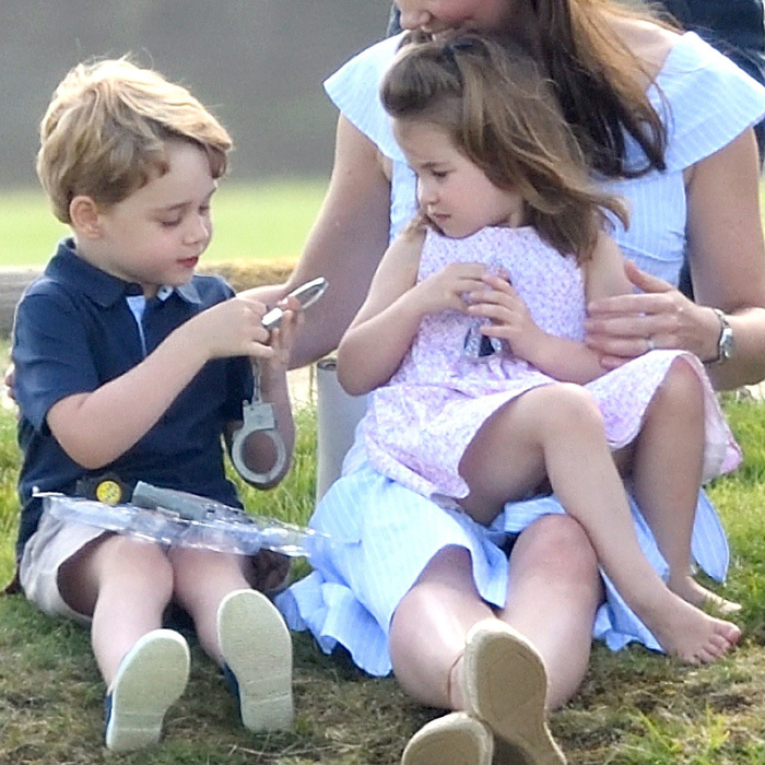 Princess Charlotte looked at her brother play with a pair of handcuffs. Throughout the day, the duo played with a slinky, handcuffs among other toys Kate Middleton brought for them.