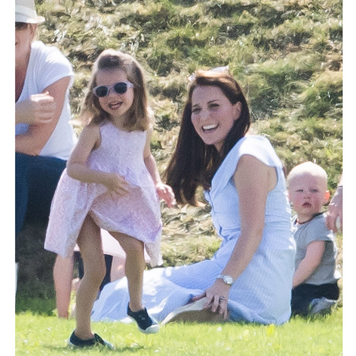 Looking just as stylish – and having a great time! –  at the Maserati Royal Charity Polo Trophy at Beaufort Park in Gloucester, England, was an animated Princess Charlotte. The little royal looked adorable in canvas shoes and pink sunglasses for her fun family day out.