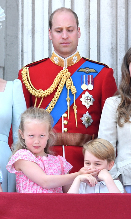 Prince William gave the ultimate dad look to cousin Peter Phillips' daughter Savannah Phillips as the seven-year-old helped keep the peace at Trooping the Colour. The little girl apparently didn't appreciate Prince George's rendition of the National Anthem, and decided to give him a hand in staying quiet. 