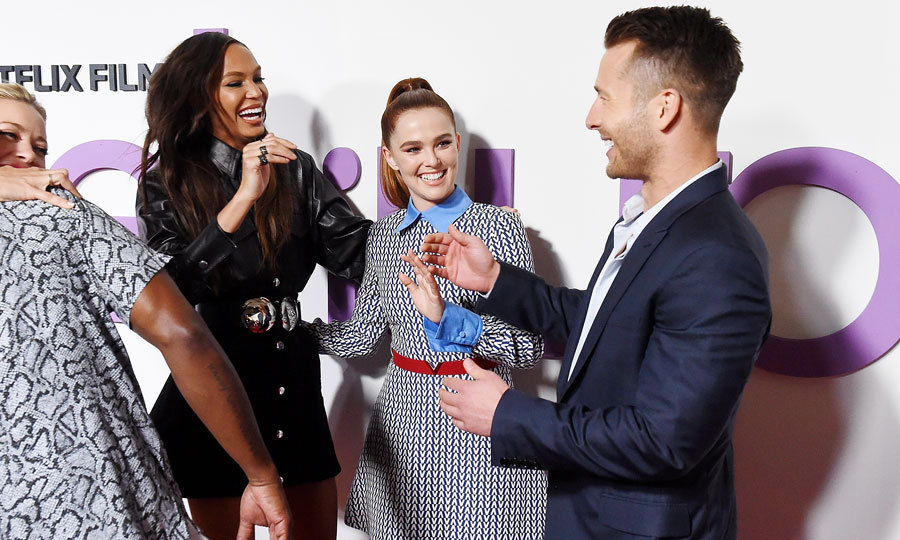 Joan Smalls, Zoey Deutch and Glen Powell shared a candid moment on the red carpet of <i>Set it Up</i> between photos in NYC.