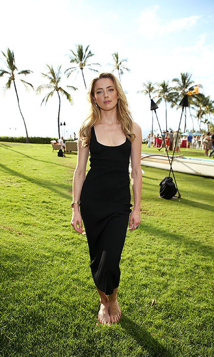 A barefoot Amber Heard was enjoying Hawaiian hospitality at the 2018 Maui Film Festival's Taste of Summer opening party on June 13 in Wailea.