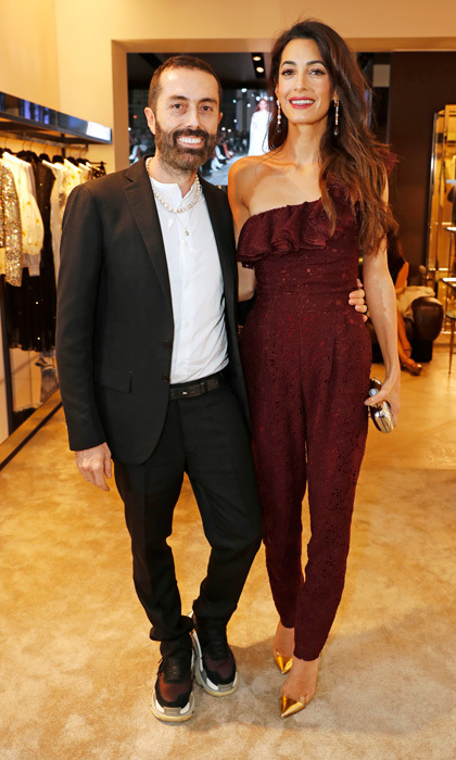 Amal Clooney left her kids at home for a stylish night out celebrating Giambattista Valli's new store in London. The human rights attorney wowed for the occasion donning a jumpsuit from the designer label that showed off her trim figure. 