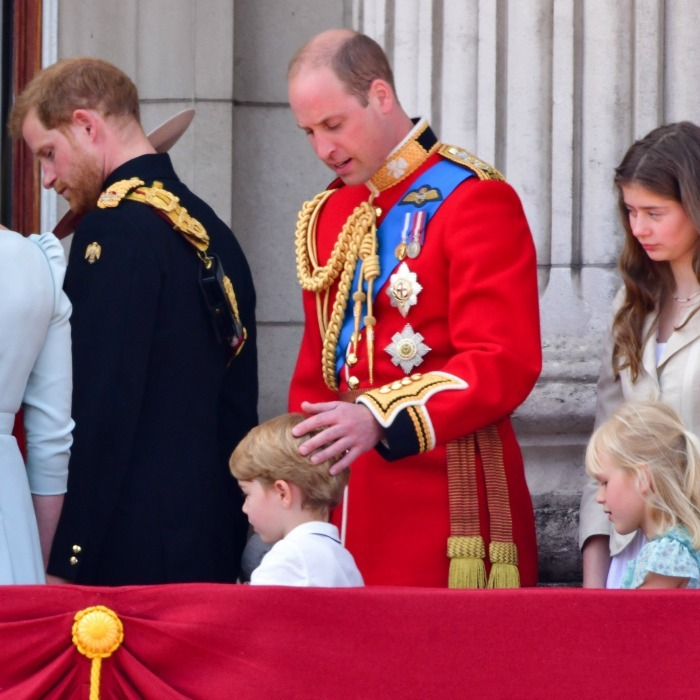 Prince William lovingly ruffled his son George's hair, as the royals exited their palace balcony during the 2018 Trooping the Colour. 