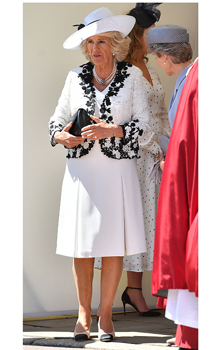Supporting husband Prince Charles was Camilla, the Duchess of Cornwall, who wore a white dress and lace jacket for the occasion. The royal topped her ensemble with a summery black and white hat. 