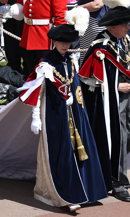 "Princess Anne, the Queen's only daughter, was appointed to the Order of the Garter in 1994. Here, the 67-year-old is seen making her arrival in the traditional costume of the Order, which has as its motto: <I>Honi soit qui mal y pense</I> – ""Shame on him who thinks this evil"".