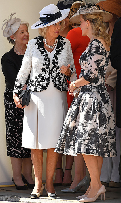 Joining Duchess Camilla was Sophie, the Countess of Wessex. Prince Edward's wife wore a 1950s-inspired print dress, pink shoes and a feathered hat to match.