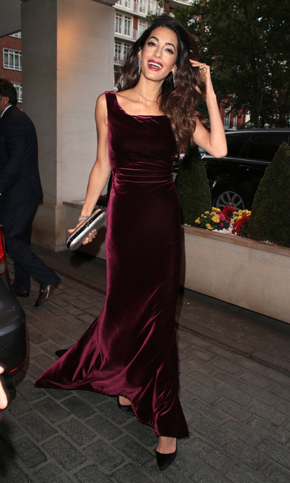 Amal Clooney stepped out once again in burgundy, proving it is her color of the season. The human rights attorney wore a gorgeous velvet gown to the WAAAUB Uk Chapter gala in London sans George.