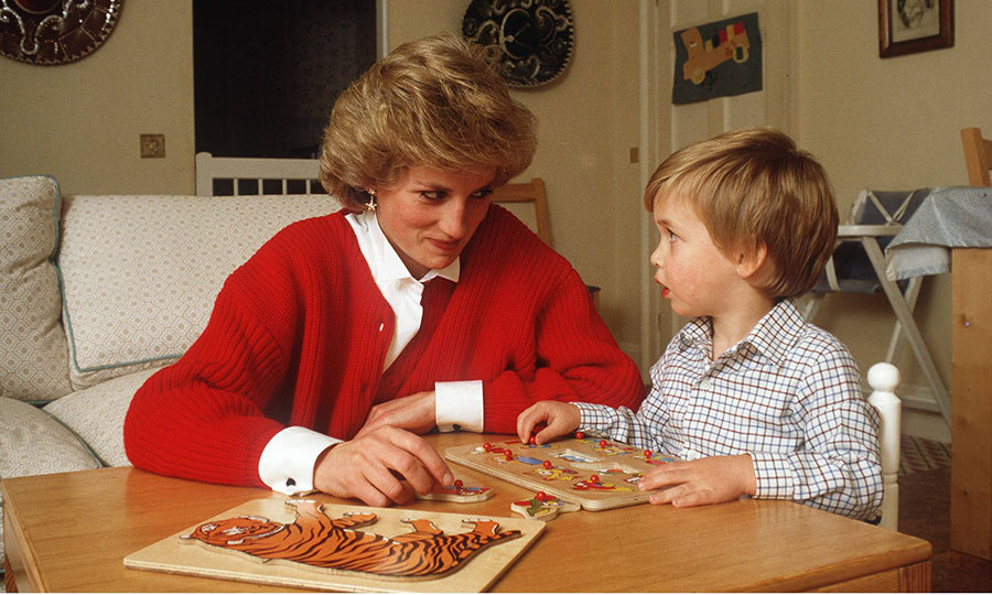 Doting mother Princess Diana was pictured helping her little boy put together a set of puzzles while at the family's Kensington Palace home. This photo was taken in 1985.