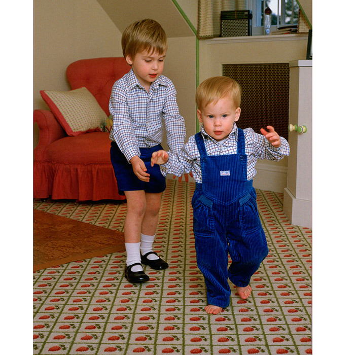 I've got you, Harry! Prince William had little brother Prince Harry's back in 1985, as the toddler tried to walk on his own in the boys' playroom at Kensington Palace.