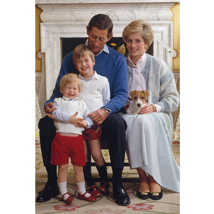 The family-of-four – plus one furry friend! Prince Charles and Princess Diana posed for this cozy portrait with the boys in front of the fireplace at Kensington Palace in December 1986. 