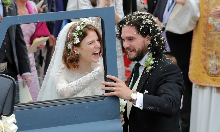 Pictured here: Kit and Rose departed Rayne Church in an older Defender car. 