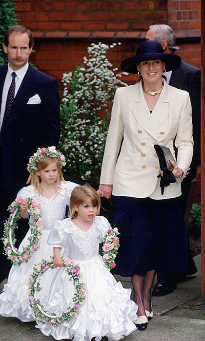 On April 24, 1993, the Duchess Of York held Princess Beatrice's hand as she and little sister Eugenie served as bridesmaids at their former nanny's wedding.