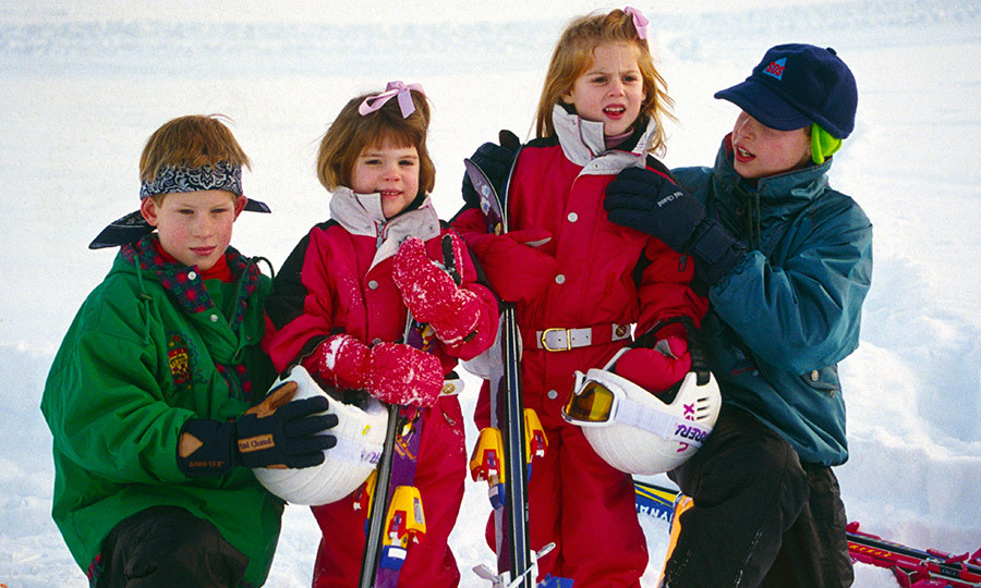 You can't look at Beatrice and Eugenie's childhood without seeing a glimpse of their royal cousins, Prince William and Prince Harry! Here the foursome are seen in January 1995 during a ski vacation in Klosters, Switzerland. William, right, adorably helped Beatrice with the collar of her ski suit. 