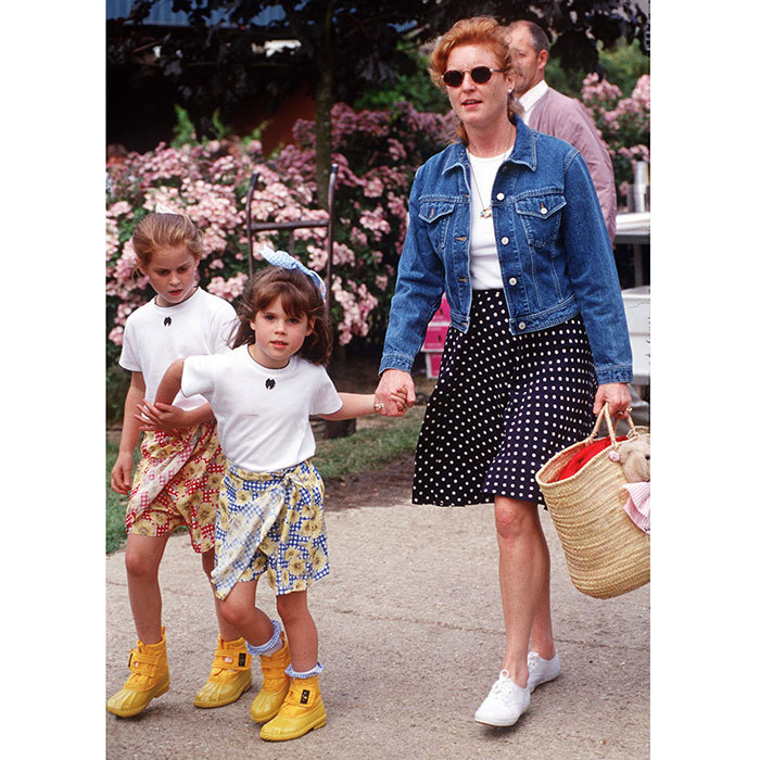 The Olsen twins had nothing on these two! Holding hands with mother Sarah Ferguson in July 1996, Princess Beatrice and Princess Eugenie showed off their colourful mid-1990s style in yellow boots and printed sarong skirts. 