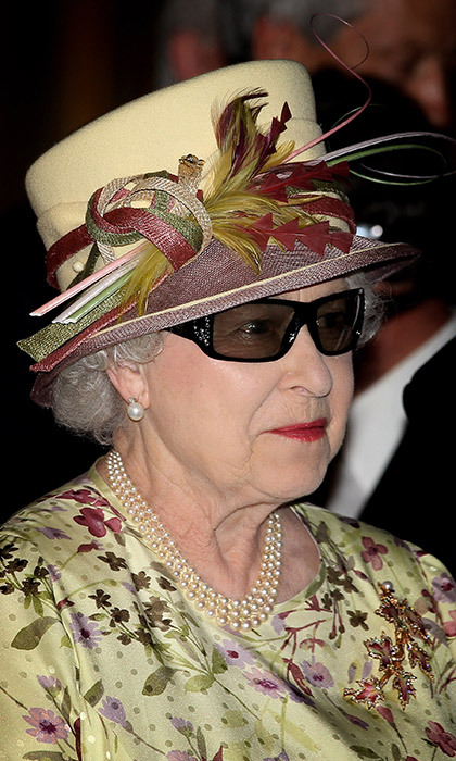 Queen Elizabeth II looked like a monarch from the future in these specially designed 3D spectacles! She wore the glasses to watch a 3D display during a visit to Pinewood Studios in Toronto, Canada on July 5, 2010.