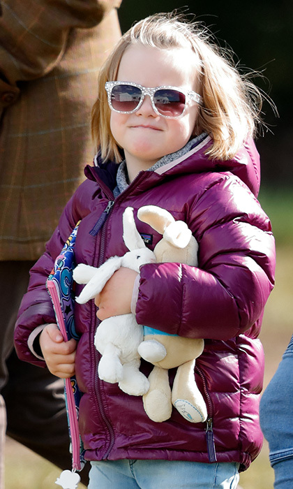 A fashion icon in the making! Queen Elizabeth's always-adorable great-granddaughter Mia Tindall was well equipped at the Gatcombe Horse Trials on March 25, 2018 in Stroud, England. The little girl carried a pair of stuffed animal toys and sported white patterned sunnies.