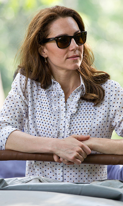 Catherine, Duchess of Cambridge let her hair down as she rode in an open air Jeep wearing Ray Bans while on safari at Kaziranga National Park on April 13, 2016 in Guwahati, India. The royal was on tour with husband Prince William. 