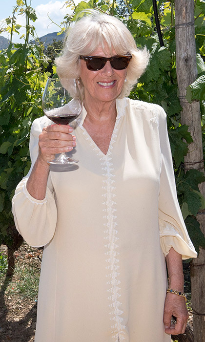 Cheers! Camilla, the Duchess of Cornwall wore classic Ray Bans as she joined in on a wine tasting reception during a visit to Lyrarakis Winery on May 11, 2018 in Crete, Greece. 