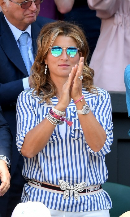 Proud wife Mirka Federer was in the stands cheering on her husband Roger, who embarked on the quest for his ninth Wimbledon title. She made for a stylish appearance in a striped blue and white top and a Gucci belt. 