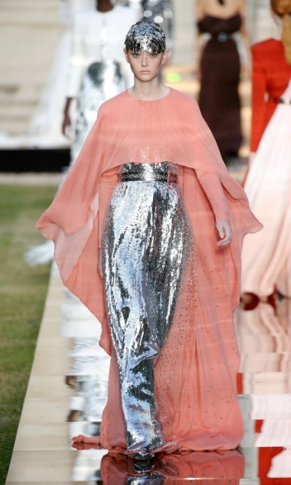 This haute couture look number 38 is called 'Exaltante'. Between the sparkling sequin dress and flowing flamingo-colored top, we could see Meghan wearing this for a royal night out.