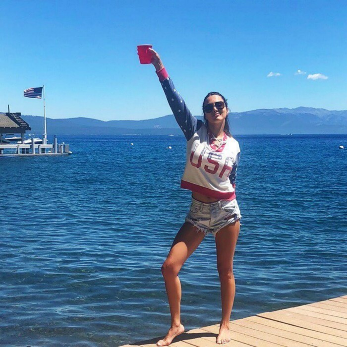 Cheers to America! Andi Dorfman showed off her toned legs in cut-off shorts, a USA sweatshirt and killer views as she celebrated from Lake Tahoe.