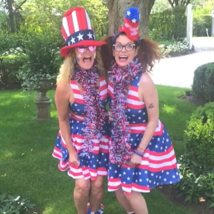 Debra Messing and a girlfriend wore matching dresses for their day of fun. The <i>Will & Grace</i> star enjoyed the parade in Nantucket in her red, white and blue.