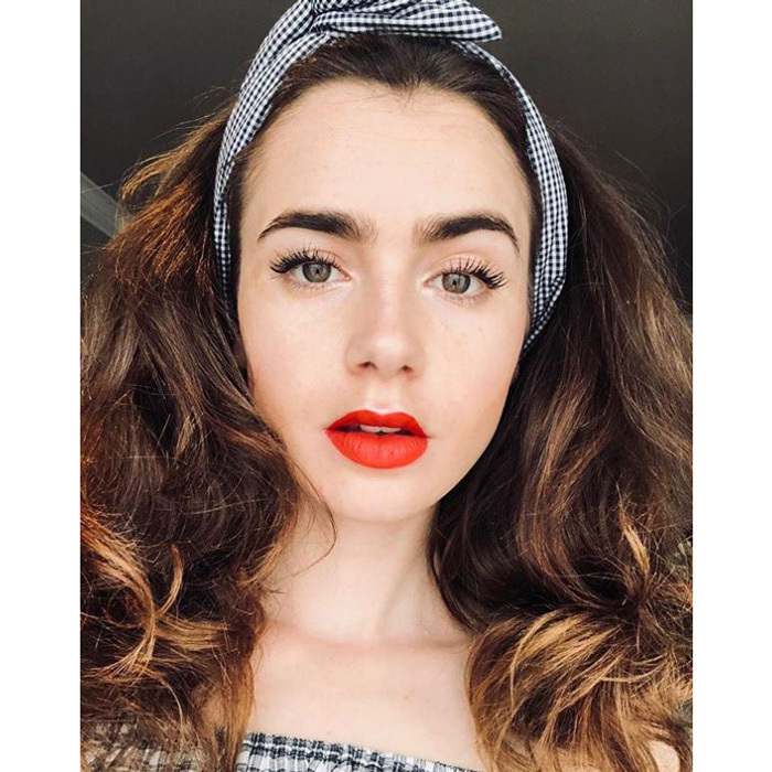 "Lily Collins' glam was feeling patriotic. The British-American actress wrote on Instagram: ""Rockabilly Lily bringing the festivities to Europe. Happy 4th of July!...""