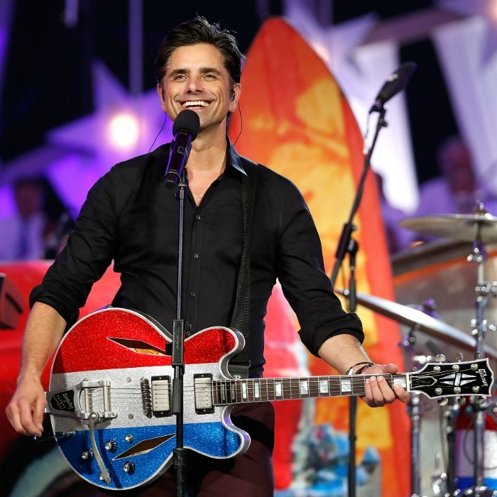 John Stamos' Fourth rocked! The <i>Fuller House</i> star performed with his favorite band The Beach Boys at the 2018 A Capitol Fourth Concert at the U.S. Capitol, West Lawn in Washington, DC. 